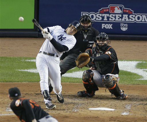 New York Yankees&#39; Mark Teixeira hits a single against Baltimore Orioles pitcher Jason Hammel during the fifth inning in Game 5 of the American League division baseball series on Friday, Oct. 12, 2012, in New York. Orioles&#39; catcher Matt Wieters and home plate umpire Mike Everitt watch the hit. &#40;AP Photo&#47;Peter Morgan&#41; <span class=meta>(AP Photo&#47; Peter Morgan)</span>