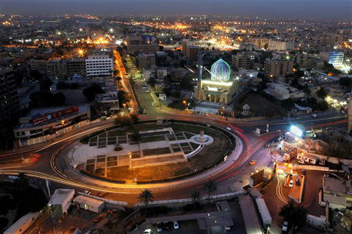 "<div class=""meta ""><span class=""caption-text "">In this Sunday, April 7, 2013 photo, a general view of Firdous Square, where the statue of Saddam Hussein was pulled down by U.S. forces and Iraqis on April 9, 2003, in central Baghdad, Iraq. Ten years ago, a statue fell in Paradise Square. Joyful Iraqis helped by a U.S. Army tank retriever pulled down their longtime dictator, cast as 16 feet of bronze. The scene broadcast live worldwide became an icon for a war, a symbol of final victory over Saddam Hussein. But for the people of Baghdad, it was only the beginning. The toppling of the statue on April 9, 2003, remains a potent symbol that has divided Iraqis ever since.  (AP Photo/ Hadi Mizban) (AP Photo/ Hadi Mizban)</span></div>"