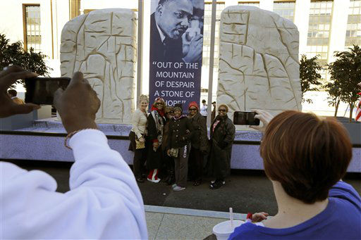 People take a picture of a group with the Martin Luther King float prepared for the 57th Presidential Inaugural Parade, Sunday, Jan. 20, 2013 in Washington. Thousands are planning to march in the 57th Presidential Inauguration parade after the ceremonial swearing-in of President Barack Obama on Monday. &#40;AP Photo&#47;Alex Brandon&#41; <span class=meta>(AP Photo&#47; Alex Brandon)</span>