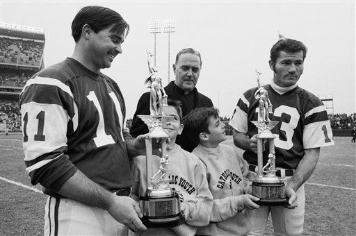 Jim Turner, left, of the New York jets is presented with trophy at New York&#39;s Shea Stadium, Dec. 1, 1968. At right is Don Maynard. &#40;AP Photo&#41; <span class=meta>(Photo&#47;XJFM)</span>