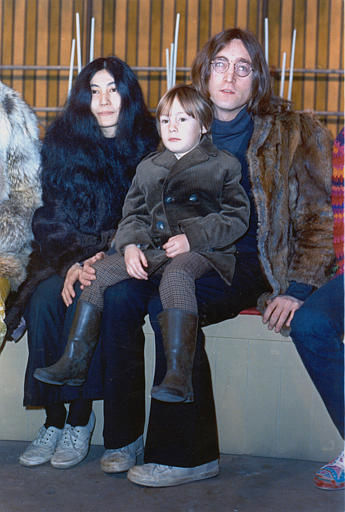 Beatle John Lennon poses with his son Julian, sitting on his lap, and his companion Yoko Ono at an unknown location in 1968.  &#40;AP Photo&#41; <span class=meta>(AP Photo&#47; XNBG)</span>