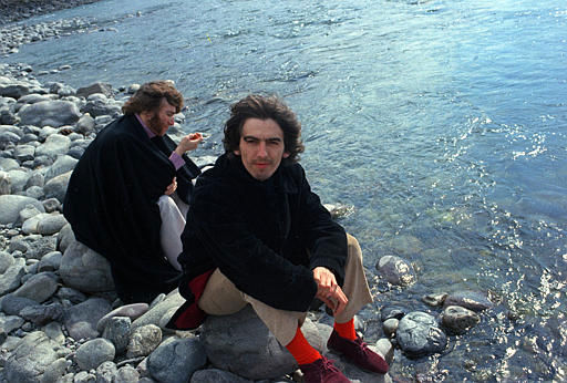 "<div class=""meta ""><span class=""caption-text "">Beatles George Harrison and John Lennon, background, sit on rocks by a river in Rishikesh, India, in 1968.  They are studying transcendental meditation with their yogi.  (AP Photo) (AP Photo/ XNBG)</span></div>"