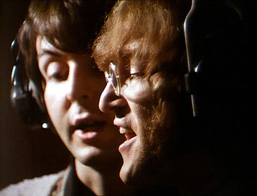 Beatles members John Lennon and Paul McCartney sing their harmonizing vocal lines in the Abbey Road Studios in London, England, February 11, 1968, during a recording session. &#40;AP Photo&#41; <span class=meta>(AP Photo&#47; GH)</span>