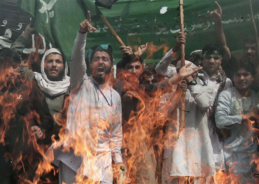 "<div class=""meta ""><span class=""caption-text "">Afghans shout as they burn a U.S. flag, not seen, during a demonstration in Jalalabad, Afghanistan, condemning last week's air strike in Kunar, Monday, April 15, 2013. Hundreds of students in eastern Afghanistan shouted angry slogans against the United States and U.S. soldiers accusing them of carrying out the killings of civilians in Kunar.  (AP Photo/Rahmat Gul) (AP Photo/ Rahmat Gul)</span></div>"