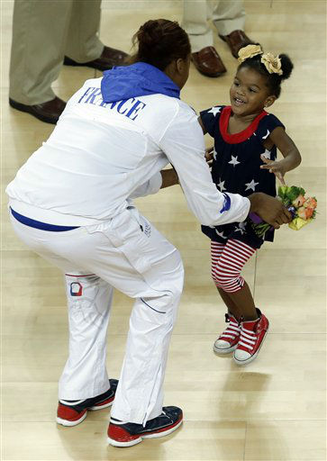 Lailaa Williams, the 3-year-old daughter of United States&#39; player Candace Parker, runs towards France&#39;s Sandrine Gruda after the medal ceremony for the women&#39;s gold medal basketball game at the 2012 Summer Olympics, Saturday, Aug. 11, 2012, in London. &#40;AP Photo&#47;Victor R. Caivano&#41; <span class=meta>(AP Photo&#47; Victor R. Caivano)</span>