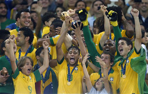 Brazil&#39;s Neymar, center, lifts the trophy after winning the soccer Confederations Cup final between Brazil and Spain at the Maracana stadium in Rio de Janeiro, Brazil, Sunday, June 30, 2013. &#40;AP Photo&#47;Bruno Magalhaes&#41; <span class=meta>(AP Photo&#47; Bruno Magalhaes)</span>