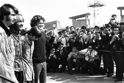 The pop musical group, The Monkees, arrived at Tokyo International Airport Sept. 30, 1968 for the performances in Tokyo, Kyoto and Osaka. About 1,000 Japanese fans, mostly teen aged girls gathered at the airport to see The Monkees. From right Micky Dolenz, Davy Jones, Peter Tork, Mike Nesmith. About 700 Japanese police surrounded the airport to protect Monkees from crowd but no mob scene. &#40;AP Photo&#41; <span class=meta>(AP Photo&#47; XJM)</span>