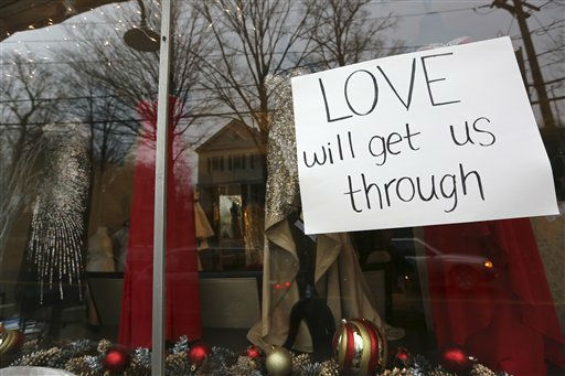 A sign hangs in the window of a clothing store Sunday, Dec. 16, 2012 in Newtown, Conn. On Friday, a gunman allegedly killed his mother at their home and then opened fire inside the Sandy Hook Elementary School, killing 26 people, including 20 children. &#40;AP Photo&#47;Mary Altaffer&#41; <span class=meta>(AP Photo&#47; Mary Altaffer)</span>