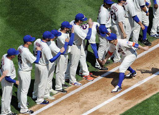 New York Mets&#39; David Wright greets teammates on the field as he is introduced during Opening Day ceremonies before the baseball game against the San Diego Padres at Citi Field on Monday, April 1, 2013 in New York. &#40;AP Photo&#47;Kathy Kmonicek&#41; <span class=meta>(AP Photo&#47; Kathy Kmonicek)</span>