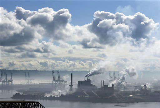 A blue sky begins to emerge from early morning clouds and fog as the Simpson Tacoma Kraft Company pulp and paper mill operates along with cargo container cranes at the Port of Tacoma, Thursday, May 16, 2013, in Tacoma, Wash. &#40;AP Photo&#47;Ted S. Warren&#41; <span class=meta>(AP Photo&#47; Ted S. Warren)</span>