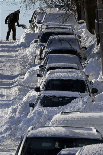 A man shoves his car out of the snow on M street in the South Boston neighborhood of Boston, early Sunday, Feb. 10, 2013. &#40;AP Photo&#47;Gene J. Puskar&#41; <span class=meta>(AP Photo&#47; Gene J. Puskar)</span>
