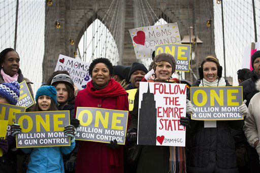 Demonstrators march over the Brooklyn bridge towards downtown Manhattan during the One Million Moms for Gun Control Rally, Jan. 21, 2012, in New York. Demonstrators called for new gun control legislation, demanding a ban on assault weapons and stricter regulations on gun purchases. &#40;AP Photo&#47;John Minchillo&#41; <span class=meta>(AP Photo&#47; John Minchillo)</span>