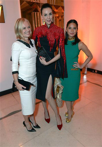 Mariella Frostrup, L'Wren Scott, winner of the Tastemaker of the Year award, and Olivia Munn at Harper's Bazaar Women of the Year Awards 2013 at Claridge's Hotel on Tuesday, Nov. 5, 2013, in London. (Photo by Jon Furniss/Invision for Harper's Bazaar/AP)