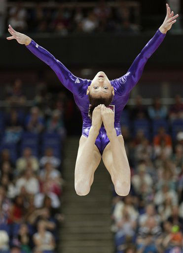 "<div class=""meta image-caption""><div class=""origin-logo origin-image ""><span></span></div><span class=""caption-text"">U.S. gymnast Kyla Ross performs on the balance beam during the Artistic Gymnastics women's qualification at the 2012 Summer Olympics, Sunday, July 29, 2012, in London. (AP Photo/Gregory Bull) (AP Photo/ Gregory Bull)</span></div>"