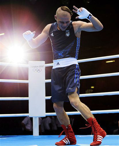 Denys Berinchyk of Ukraine, does a dance after his fight against Roniel Iglesias Sotolongo of Cuba, at the men&#39;s light welterweight 64-kg gold medal boxing match at the 2012 Summer Olympics, Saturday, Aug. 11, 2012, in London. &#40;AP Photo&#47;Ivan Sekretarev&#41; <span class=meta>(AP Photo&#47; Ivan Sekretarev)</span>