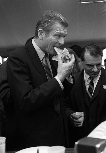 New York Mayor John Lindsay bites into a slice of pizza while touring the boroughs of Brooklyn and Queens shortly after announcing his bid for re-election on March 18, 1969.  <span class=meta>(AP Photo&#47;John Rooney)</span>