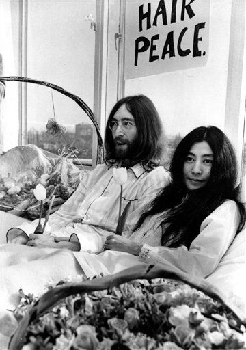 "<div class=""meta ""><span class=""caption-text "">** FILE ** Beatle John Lennon and his wife, Yoko Ono, right, hold a bed-in for peace in room 902, the presidential suite at the Hilton Hotel in Amsterdam on March 25, 1969.  The newlyweds, holding solitary tulips, begin a seven-day Love-In to protest against war. Yoko Ono turns 75 on Monday Feb. 18, 2008.   (AP Photo) (AP Photo/ i)</span></div>"