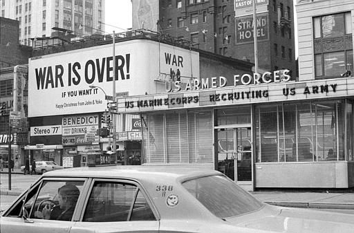 "<div class=""meta ""><span class=""caption-text "">Workmen put finishing touches on a billboard bearing a Christmas peace message from musicians and activists John Lennon and Yoko Ono in New York's Times Square, Dec. 15, 1969.  The billboard, located near the U.S. Armed Forces recruiting station, reads:  ""War Is Over!  If You Want It.  Happy Christmas from John and Yoko.""  (AP Photo) (AP Photo/ XNBG)</span></div>"