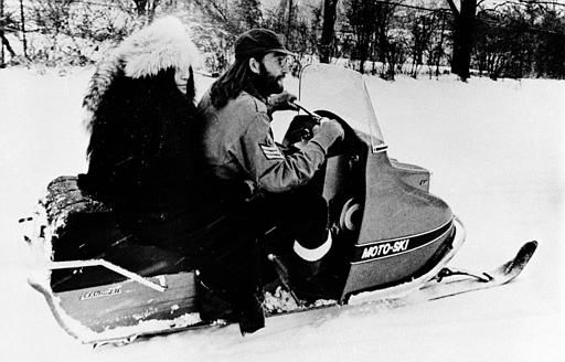 John Lennon, right, and his wife, Yoko Ono, take their first ride on a snowmobile on a farm owned by rock singer Ronnie Hawkins at Mississauga, Ontario, Canada, Dec. 18, 1969.  Lennon and Ono are staying on the farm during their peace crusade in Canada. &#40;AP Photo&#41; <span class=meta>(AP Photo&#47; XNBG)</span>