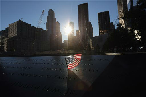 A flag flies over the National September 11 Memorial before observances marking the eleventh anniversary of the attacks on the World Trade Center, Tuesday, Sept. 11, 2012 in New York.  &#40;AP Photo&#47;John Moore, Pool&#41; <span class=meta>(AP Photo&#47; John Moore)</span>