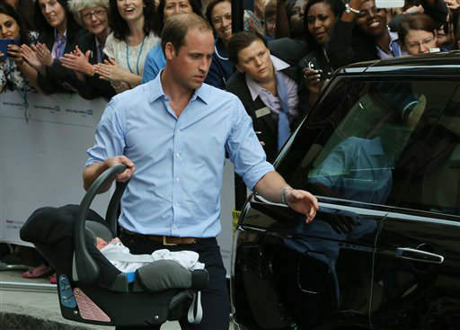 Britain's Prince William, carries the Prince of Cambridge to the car, Tuesday July 23, 2013, as they leave St. Mary's Hospital exclusive Lindo Wing in London where the Duchess gave birth on Monday July 22. The Royal couple are expected to head to London?s Kensington Palace from the hospital with their newly born son, the third in line to the British throne.(Photo by Joel Ryan/Invision/AP)