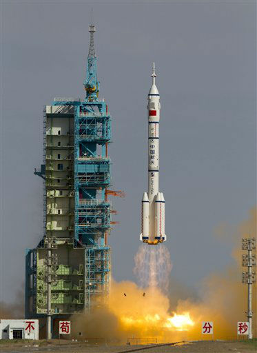 "<div class=""meta image-caption""><div class=""origin-logo origin-image ""><span></span></div><span class=""caption-text"">The Long March 2F rocket carrying the Shenzhou 10 capsule blasts off from the Jiuquan Satellite Launch Center in Jiuquan, northwest China's Gansu Province, Tuesday, June 11, 2013. The Shenzhou 10 capsule carrying three astronauts lifted off on a 15-day mission to dock with a space lab and to educate young people about science. (AP Photo/Andy Wong) (AP Photo/ Andy Wong)</span></div>"