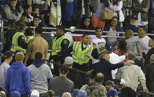 San Diego police with the help of Petco Park security make arrest while breaking up a fight in the stands during baseball game between the San Diego Padres and the Los Angeles Dodgers in San Diego, Thursday, April 11, 2013. The Padres and Dodgers engaged in a braw in the sixth inning before fights broke out in the stands. &#40;AP Photo&#47;Lenny Ignelzi&#41; <span class=meta>(AP Photo&#47; Lenny Ignelzi)</span>