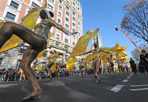 Dancers fill the street as the 86th annual Macy&#39;s Thanksgiving Day Parade moves down New York&#39;s Central Park West Thursday, Nov 22, 2012. &#40;AP Photo&#47; Louis Lanzano&#41; <span class=meta>(AP Photo&#47; Louis Lanzano)</span>