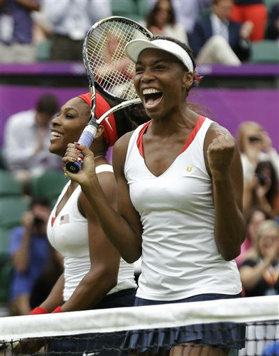 Venus Williams, right, and Serena Williams of the United States celebrate their victory against Andrea Hlavackova and Lucie Hradecka of the Czech Republic during the gold medal women&#39;s doubles match at the All England Lawn Tennis Club in Wimbledon, London at the 2012 Summer Olympics, Sunday, Aug. 5, 2012. &#40;AP Photo&#47;Elise Amendola&#41; <span class=meta>(AP Photo&#47; Elise Amendola)</span>