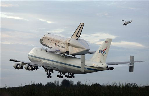 Space shuttle Endeavour, bolted atop a modified jumbo jet makes its departure from the Kennedy Space Center,  Wednesday, Sept. 19, 2012, in Cape Canaveral, Fla. Endeavour will make a stop in Houston before heading to the California Science Center in Los Angeles. &#40;AP Photo&#47;Terry Renna&#41; <span class=meta>(AP Photo&#47; Terry Renna)</span>