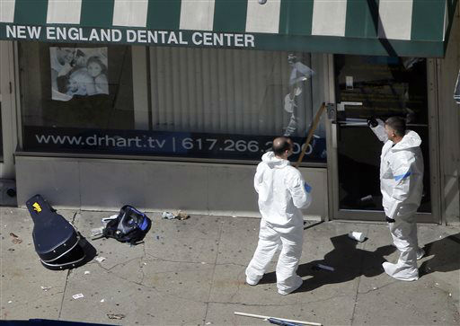 "<div class=""meta ""><span class=""caption-text "">Two men in haz-mat suits investigate the scene near the first bombing on Boylston Street in Boston Tuesday, April 16, 2013 near the finish line of the 2013 Boston Marathon, a day after two blasts nearby killed at least three and injured over 170 people. (AP Photo/Elise Amendola) (AP Photo/ Elise Amendola)</span></div>"