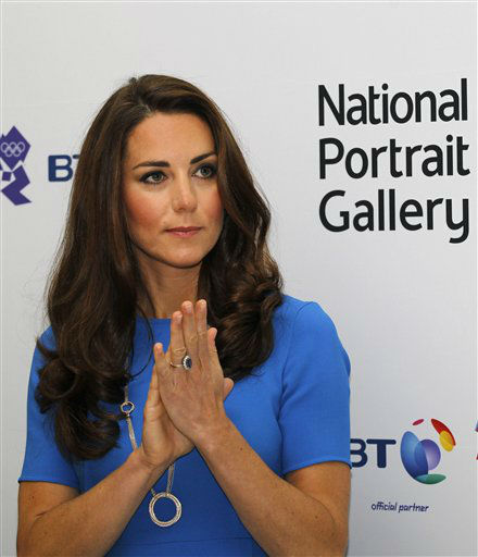 Kate, Duchess of Cambridge reacts as she listens to a speech during her visit to &#39;Road to 2012 : Aiming High&#39; exhibition at the National Portrait Gallery in London, Thursday, July 19, 2012. The Duchess of Cambridge is the Patron of the National Portrait Gallery. The exhibition showcase commissioned photographs documenting the preparations for London 2012 Olympics. &#40;AP Photo&#47;Sang Tan, Pool&#41; <span class=meta>(AP Photo&#47; Sang Tan)</span>