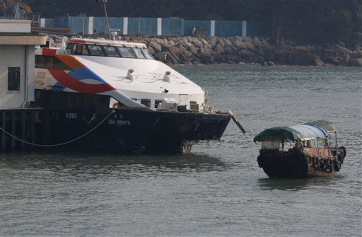 A damaged ferry is docked at a pier after colliding with a boat in Lamma Island, off the southwestern coast of Hong Kong Tuesday, Oct. 2, 2012. The ferry on Monday collided with a boat owned by utility company Power Assets Holdings Ltd., which was taking its workers and their families to famed Victoria Harbor to watch a fireworks display in celebration of China&#39;s National Day and mid-autumn festival, killing at least 36 people. &#40;AP Photo&#47;Kin Cheung&#41; <span class=meta>(AP Photo&#47; Kin Cheung)</span>