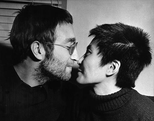 John Lennon and his wife Yoko Ono share an Eskimo kiss &#40;rubbing noses&#41; during an interview in London, Feb. 9, 1970.  Both had their hair shorn in Denmark to be auctioned off in London.  The proceeds will go to the Black Power organization in Britain.  &#40;AP Photo&#47;Bob Dear&#41; <span class=meta>(AP Photo&#47; BOB DEAR)</span>
