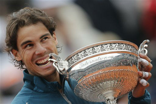 "<div class=""meta image-caption""><div class=""origin-logo origin-image ""><span></span></div><span class=""caption-text"">Spain's Rafael Nadal bites the trophy after winning against compatriot David Ferrer in three sets 6-3, 6-2, 6-3, in the final of the French Open tennis tournament, at Roland Garros stadium in Paris, Sunday June 9, 2013. (AP Photo/Christophe Ena) (AP Photo/ Christophe Ena)</span></div>"