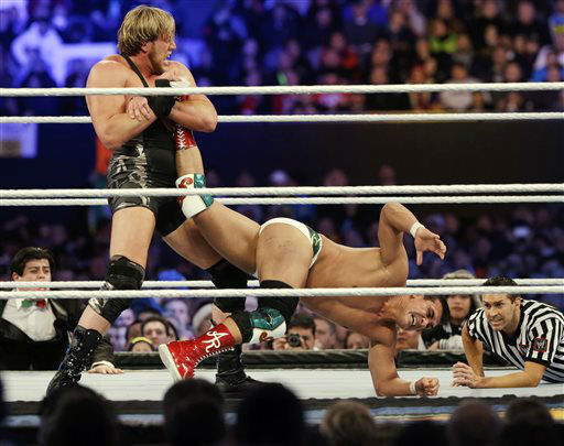 Jacob &#34;Jake&#34; Hager, Jr., known as Jack Swagger, left, locks up the leg of Jose Alberto Rodr&#237;guez, of Mexico, known as Alberto Del Rio, during the WWE Wrestlemania 29 wrestling event, Sunday, April 7, 2013, in East Rutherford, N.J. &#40;AP Photo&#47;Mel Evans&#41; <span class=meta>(AP Photo&#47; Mel Evans)</span>