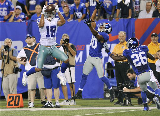 "<div class=""meta ""><span class=""caption-text "">Dallas Cowboys wide receiver Miles Austin (19) catches a pass as New York Giants defensive back Justin Tryon (30) and Antrel Rolle (26) defend during the second half of an NFL football game Wednesday, Sept. 5, 2012, in East Rutherford, N.J. Austin scored a touchdown on the play. (AP Photo/Bill Kostroun) (AP Photo/ Bill Kostroun)</span></div>"