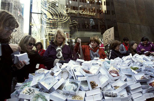 "<div class=""meta ""><span class=""caption-text "">Shoppers on New York's Fifth Ave. patronize a street vendor featuring $5 jewelry, Friday, Nov. 23, 2012. Black Friday, the day when retailers traditionally turn a profit for the year, got a jump start this year as many stores opened just as families were finishing up Thanksgiving dinner.</span></div>"