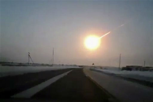 In this frame grab made from a video done with a dashboard camera, on a highway from Kostanai, Kazakhstan, to Chelyabinsk region, Russia, provided by Nasha Gazeta newspaper, on Friday, Feb. 15, 2013 a meteorite contrail is seen. A meteor streaked across the sky of Russia?s Ural Mountains on Friday morning, causing sharp explosions and reportedly injuring around 100 people, including many hurt by broken glass. &#40;AP Photo&#47;Nasha gazeta, www.ng.kz&#41; <span class=meta>(AP Photo&#47; Uncredited)</span>