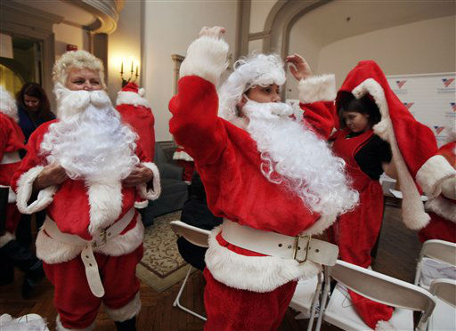 Kathy Trezza, left  and her daughter Kathryn Trezza, suit up at Volunteers of America headquarters for the 110th annual Sidewalk Santa Parade, in New York,  Friday, Nov. 23, 2012. The donations they raise are used for a holiday food voucher program for needy residents. &#40;AP Photo&#47;Richard Drew&#41; <span class=meta>(AP Photo&#47; Richard Drew)</span>
