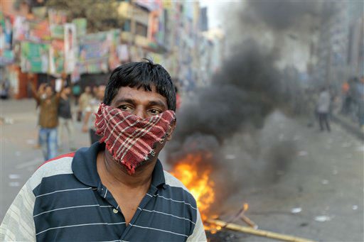 "<div class=""meta ""><span class=""caption-text "">A Bangladeshi opposition activist looks after they burn a street vendor's cart as they clash with police during their protest in Dhaka, Bangladesh, Monday, March 11, 2013. The protest was called by an alliance of 18 parties to denounce trials of several opposition politicians accused of mass killings and atrocities during Bangladesh's 1971 independence war against Pakistan. (AP Photo/A.M. Ahad)</span></div>"