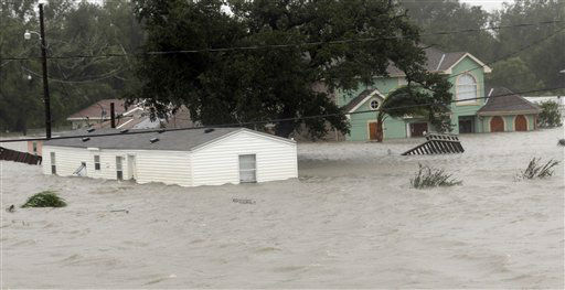 Homes are flooded as Hurricane Isaac hits Wednesday, Aug. 29, 2012, in Braithwaite, La. As Isaac made landfall, it was expected to dump as much as 20 inches of rain in several parts of Louisiana. &#40;AP Photo&#47;David J. Phillip&#41; <span class=meta>(AP Photo&#47; David J. Phillip)</span>