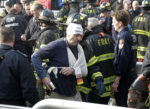 An injured passenger of the Seastreak Wall Street ferry is aided by New York City firefighters, in New York,  Wednesday, Jan. 9, 2013. The ferry from Atlantic Highlands, N.J., banged into the mooring as it arrived at South Street in lower Manhattan during morning rush hour, injuring as many as 50 people, at least one critically, officials said. &#40;AP Photo&#47;Richard Drew&#41; <span class=meta>(AP Photo&#47; Richard Drew)</span>