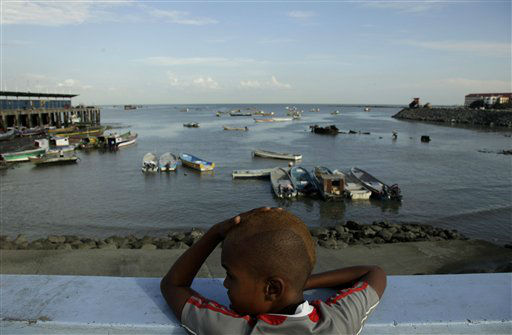 Ariel Alexis Cajar, 12, from Saboga Island, looks at fishing boats anchored at the Panama bay in Panama City, Wednesday, Dec. 19, 2012. A poll released Wednesday of nearly 150,000 people around the world says seven of the world&#39;s 10 countries with the most upbeat attitudes are in Latin America. In Panama and Paraguay, 85 percent of those polled said yes to all five, putting those countries at the top of the list. They were followed closely by El Salvador, Venezuela, Trinidad and Tobago, Thailand, Guatemala, the Philippines, Ecuador and Costa Rica. &#40;AP Photo&#47;Arnulfo Franco&#41; <span class=meta>(AP Photo&#47; Arnulfo Franco)</span>