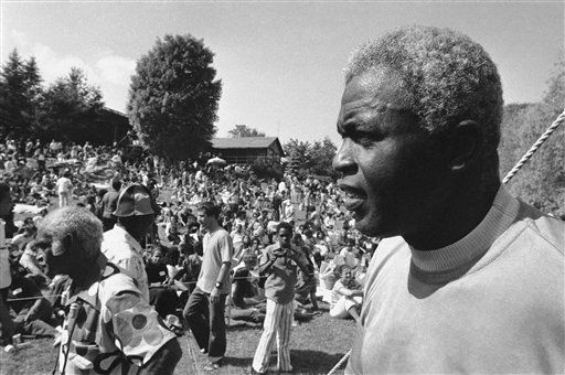 Former Baseball great Jackie Robinson, right, looks over some 2,000 persons assembled on the lawn of his home at Stamford, Connecticut on Sunday, June 27, 1971 before the opening of a Jazz Concert to benefit Daytop Inc., a drug rehabilitation center. The concert was organized by the ex-baseball star?s son, Jackie Jr., a former addict and official at the drug rehabilitation center, who died in an auto accident.   Daytop director Kenneth Williams who spoke before the concert, told the crowd: ?I want this to be a memorial for Young Jack.? &#40;AP Photo&#41; <span class=meta>(AP Photo&#47; S R  PEC XPEC)</span>