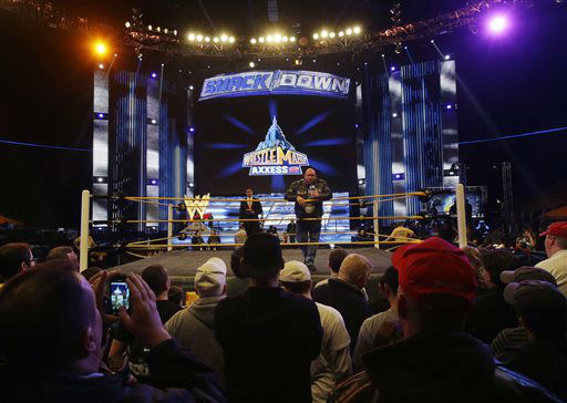 People gather ringside to listen to professional wrestler Ryan Reeves, known as Ryback, at Wrestlemania Axxess event Saturday, April 6, 2013, in East Rutherford, N.J., ahead of Sunday&#39;s Wrestlemania at MetLife stadium. &#40;AP Photo&#47;Mel Evans&#41; <span class=meta>(AP Photo&#47; Mel Evans)</span>