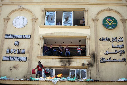 Protesters ransack the Muslim Brotherhood headquarters in the Muqatam district in Cairo, Monday, July 1, 2013. Protesters stormed and ransacked the headquarters of President Mohammed Morsi&#39;s Muslim Brotherhood group early Monday, in an attack that could spark more violence as demonstrators gear up for a second day of mass rallies aimed at forcing the Islamist leader from power. &#40;AP Photo&#47;Khalil Hamra&#41; <span class=meta>(AP Photo&#47; Khalil Hamra)</span>