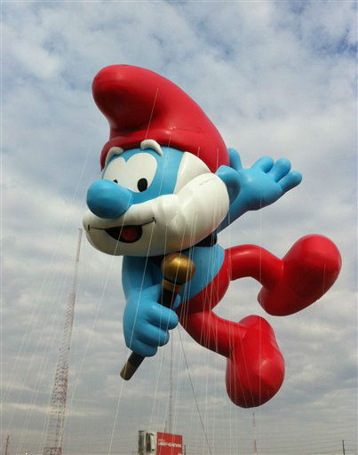 In this photo provided by Macy?s, the ?Papa Smurf? balloon floats over the Meadowland?s race track during a test flight Saturday, Nov. 10, 2012, in East Rutherford, N.J. ?Papa Smurf? is one of three new balloons to be featured in the 2012 Macy?s Thanksgiving Parade. &#40;AP Photo&#47;Macy?s, Inc.&#41; <span class=meta>(AP Photo&#47; Uncredited)</span>