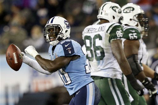 Tennessee Titans cornerback Jason McCourty &#40;30&#41; celebrates after intercepting a pass from New York Jets quarterback Mark Sanchez, not shown, intended for tight end Jeff Cumberland &#40;86&#41; in the third quarter of an NFL football game, Monday, Dec. 17, 2012, in Nashville, Tenn. Jets&#39; Brandon Moore &#40;65&#41; walks off the field. &#40;AP Photo&#47;Wade Payne&#41; <span class=meta>(AP Photo&#47; Wade Payne)</span>