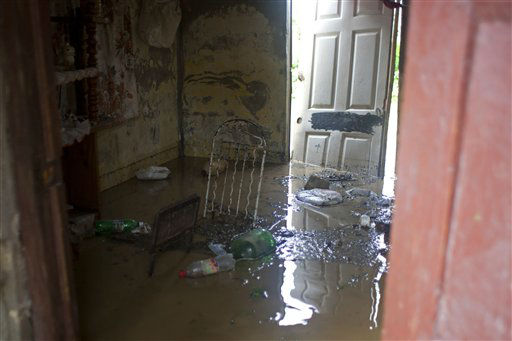 "<div class=""meta ""><span class=""caption-text "">The interior of a home is filled with floodwater brought by Tropical Storm Isaac in Port-au-Prince, Haiti, Saturday, Aug. 25, 2012. Tropical Storm Isaac swept across Haiti's southern peninsula early Saturday, dousing a capital city prone to flooding and adding to the misery of a poor nation still trying to recover from the 2010 earthquake. (AP Photo/Dieu Nalio Chery) (AP Photo/ Dieu Nalio Chery)</span></div>"